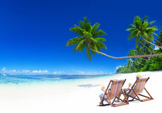 Couple Relaxing on the Tropical Beach Stock Photo