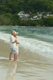 Couple  relaxing on  tropical beach. Happy elderly couple  relaxing on  tropical beach Royalty Free Stock Photo