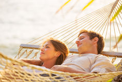 Couple relaxing in tropical hammock Royalty Free Stock Photo