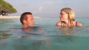 Couple Relaxing In Tropical Sea Stock Image