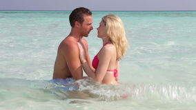 Couple Relaxing In Tropical Sea stock video footage