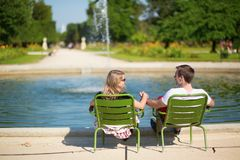 Couple relaxing in the Tuileries garden Royalty Free Stock Photo