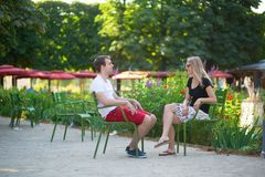 Couple relaxing in the Tuileries garden. Of Paris Royalty Free Stock Photography