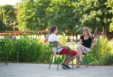 Couple relaxing in the Tuileries garden Stock Image