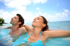 Couple relaxing in water Stock Images