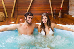 Couple relaxing in a whirlpool. Smiling couple relaxing in a whirlpool stock photography
