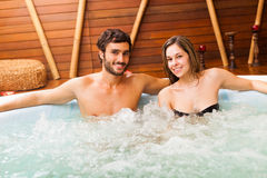Couple relaxing in a whirlpool royalty free stock photography