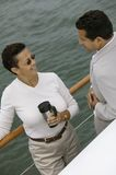 Couple relaxing on yacht Stock Images