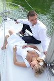 Couple relaxing on a yacht. Wedding theme. Stock Photography