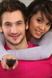 Couple with a remote control Stock Image