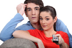 Couple with a remote control Royalty Free Stock Photo