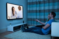 Couple with remote watching movie Stock Image