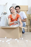 Couple removing glassware Royalty Free Stock Images