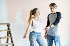 Couple renovating their house together stock image