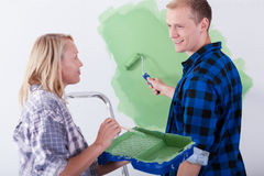 Couple renovating their new house together Stock Photos