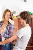 Couple renovating together as she holds up a Royalty Free Stock Photo