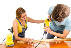 Couple renovating together as man using power Royalty Free Stock Images