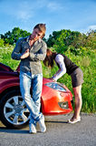 Couple repairs a broken car Royalty Free Stock Photography
