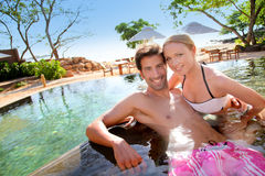 Couple in resort pool Stock Photography