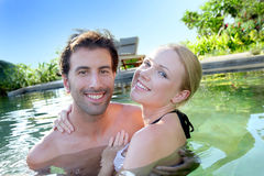 Couple in resort pool Royalty Free Stock Images
