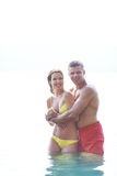 Couple on resort. Portrait of a happy couple spending time on summer resort Royalty Free Stock Photos
