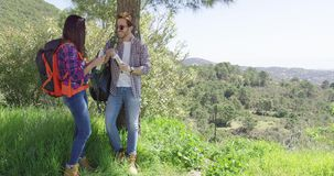 Couple on rest while hiking stock footage