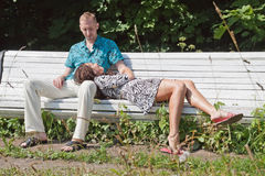 Couple rest in park. Summer Stock Photography