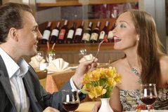 Couple in restaurant. Tasting cuisine Royalty Free Stock Image