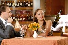 Couple in restaurant. Tasting cuisine Stock Photos