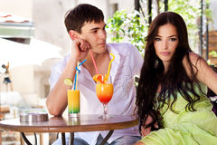 Couple in restaurant. Young couple in restaurant, outdoor, summer day Royalty Free Stock Image
