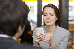 Couple in restaurant breakfasted, woman is on the phone, sms, su Stock Photos