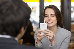 Couple in restaurant breakfasted, woman is on the phone, sms, su Royalty Free Stock Photography