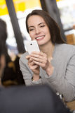 Couple in restaurant breakfasted, woman takes a picture with her Stock Images