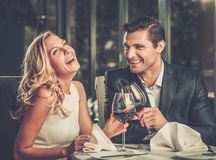 Couple in a restaurant. Cheerful couple in a restaurant with glasses of red wine Royalty Free Stock Photo