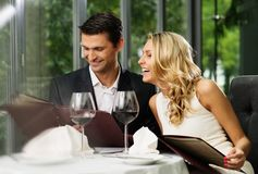 Couple in a restaurant royalty free stock images