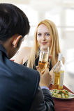 Couple at restaurant dining and toasting. Young adult seductive couple at restaurant dining and toasting Royalty Free Stock Image