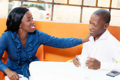 Couple at restaurant and discuss. Royalty Free Stock Photo