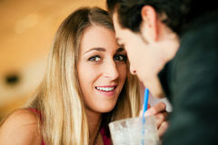 Couple in restaurant drinking milkshake Royalty Free Stock Photography