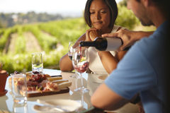 Couple at restaurant drinking red wine Stock Photo