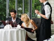 Couple in a restaurant making order Stock Photo