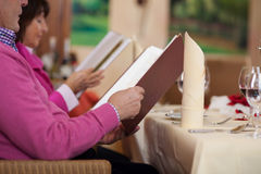 Couple in restaurant reading the menu Royalty Free Stock Photo