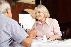 Couple in restaurant talking Stock Photography