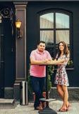 Couple in restaurant terrace. Romantic couple in restaurant terrace and smiling Stock Photography