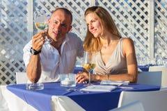 Couple drinking wine restaurant Stock Photography