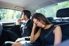 Couple resting on back seat in car Royalty Free Stock Photography