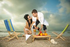 Couple resting on the beach Stock Photos