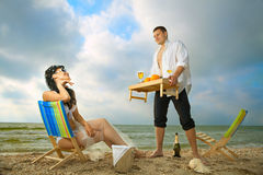Couple resting on the beach Stock Photography