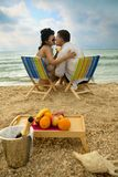 Couple resting on the beach Stock Images