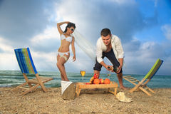 Couple resting on the beach Royalty Free Stock Photography