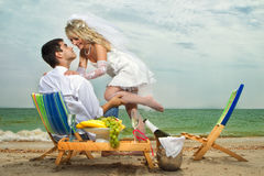 Couple resting on the beach Stock Photo